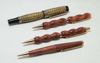 "Photo: STEVE DiBENEDETTO – 5"" x 0.75"" Pen [Stabilized Corn Cob]; Three 5"" x 0.5"" Pens [Rosewood]"