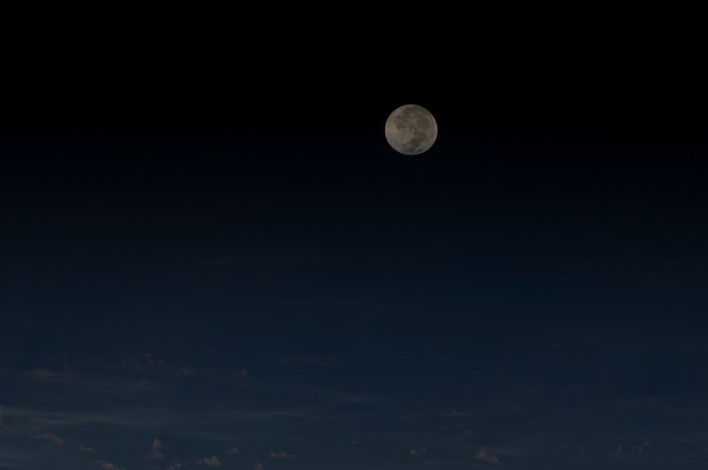 Photo: Full moon over Earth photographed from the International Space Station 19:18:29 GMT May 5, 2012. Credit: NASA