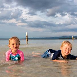 In The Water by Geoffrey Wols - Babies & Children Child Portraits ( children, beach, girl, boy, brother, sister,  )