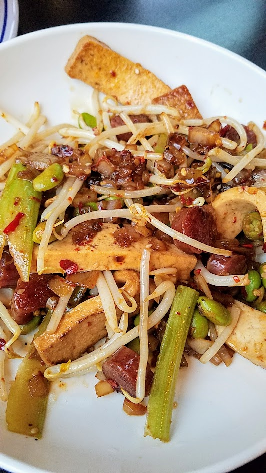 XLB Portland dish of Tofu Gan with Chinese Sausage, firm tofu marinated in soy and spices wok fried with celery, soy beans, and chinese sausage.