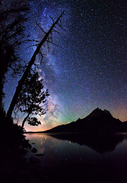 """Photo: ***EXCLUSIVE***  WYOMING - AUGUST 23: A photograph of Milky Way stars over Grand Teton Mountain Range at Grand Teton National Park on August 23, 2011 in Wyoming.  Stunningly beautiful images capture the glory of the Milky Way taken with just a simple digital camera. Revealing the Earth's place in our swirling galaxy, the pictures on display look like they could have been snapped with a million pound telescope not a readily available camera. And incredibly, photographer Royce Bair has only been turning his lens to the night's sky for the past six months. Calling his series """"Night Scapes', Royce, (insert age) created the erie and ghostly images by visiting some of America's most famous national parks.  PHOTOGRAPH BY Royce Bair / Barcroft USA  UK Office, London. T +44 845 370 2233 W www.barcroftmedia.com  USA Office, New York City. T +1 212 796 2458 W www.barcroftusa.com  Indian Office, Delhi. T +91 11 4053 2429 W www.barcroftindia.com"""