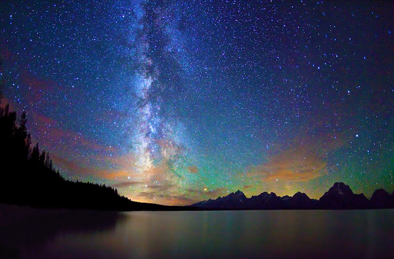 """Photo: ***EXCLUSIVE***  WYOMING - AUGUST 23: A photograph of starry night sky and Milky Way over Jackson Lake and Tetons at Grand Teton National Park on August 23, 2011 in Wyoming.  Stunningly beautiful images capture the glory of the Milky Way taken with just a simple digital camera. Revealing the Earth's place in our swirling galaxy, the pictures on display look like they could have been snapped with a million pound telescope not a readily available camera. And incredibly, photographer Royce Bair has only been turning his lens to the night's sky for the past six months. Calling his series """"Night Scapes', Royce, (insert age) created the erie and ghostly images by visiting some of America's most famous national parks.  PHOTOGRAPH BY Royce Bair / Barcroft USA  UK Office, London. T +44 845 370 2233 W www.barcroftmedia.com  USA Office, New York City. T +1 212 796 2458 W www.barcroftusa.com  Indian Office, Delhi. T +91 11 4053 2429 W www.barcroftindia.com"""