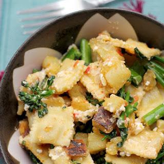 Ravioli Salad with Broccolini, Sweet Potatoes, Feta, and Harissa