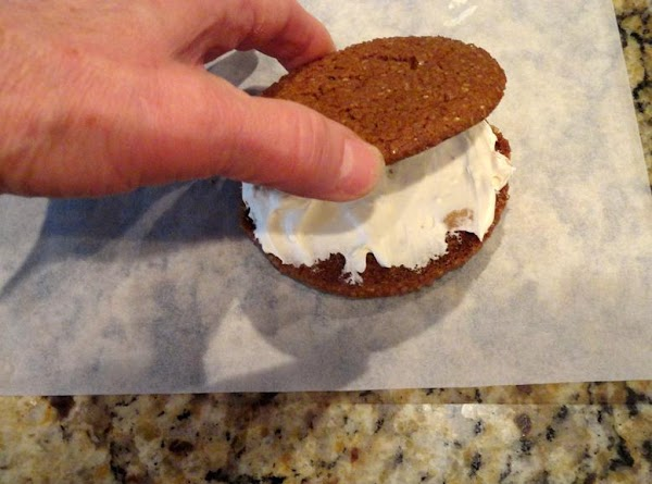 When cookies are cool, spread bottom of one cookies with 1-2t. of filling and...