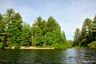 Photo: View from water of the beach at Ricker Pond State Park