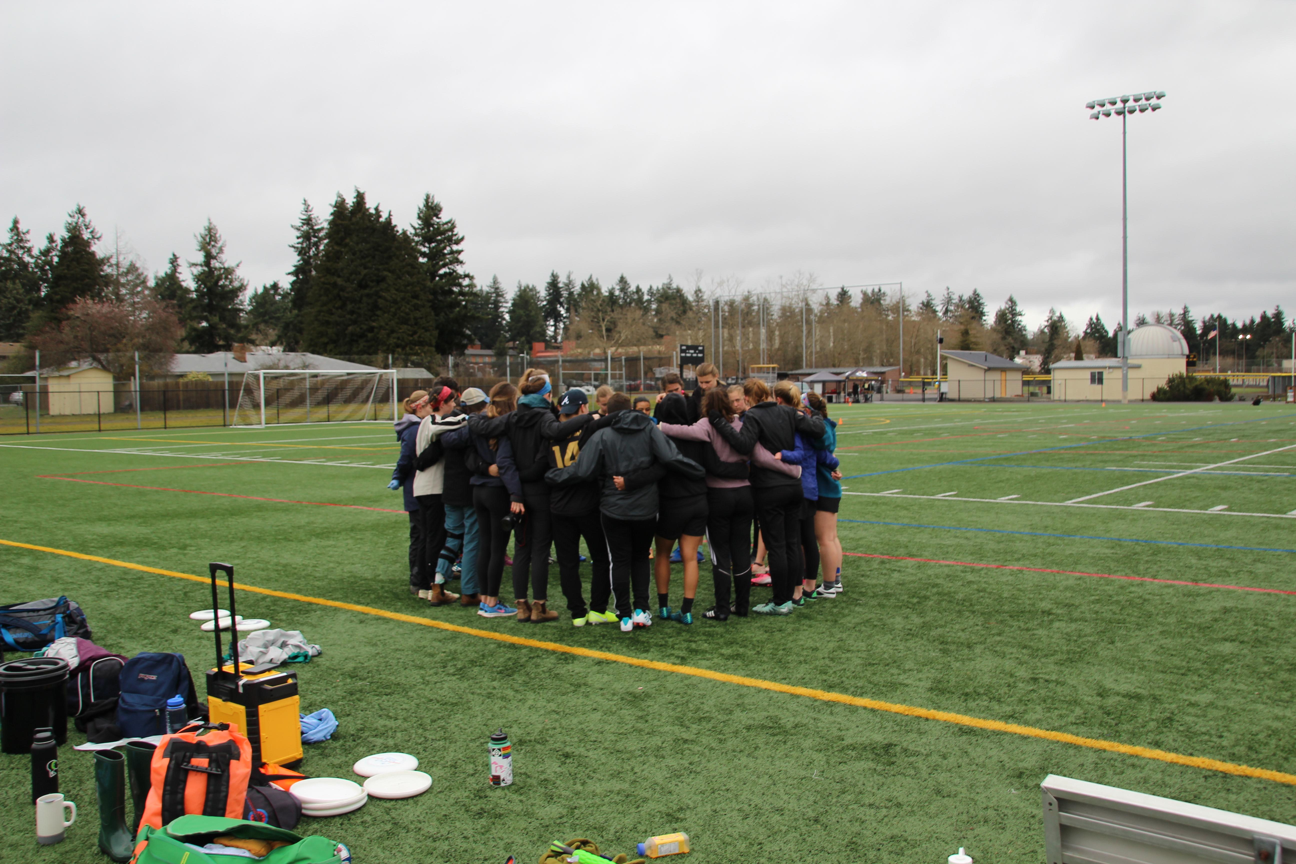 PLU BBQ pre-game team huddle