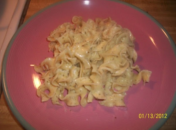 Place noodles in a serving bowl; top with garlic mixture. Sprinkle with half of...