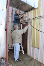 Photo: Ted and Dennis securing the coax