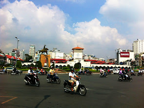 Photo: Sights from Lonely Planet Old Saigon Walking Tour.  Ben Thanh Market and statue of Tran Nguyen Han.