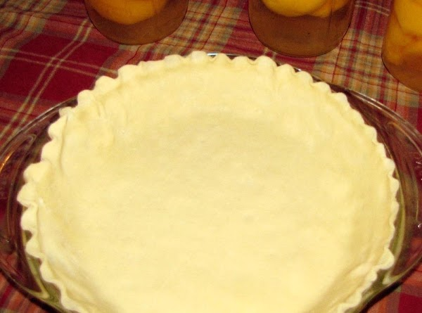 Preheat oven to 425 degrees. Fit dough into 9 inch deep dish pie plate.  Fold...