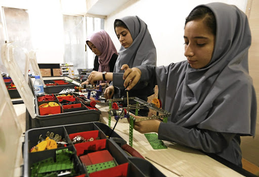 Members of the Afghan robotics team denied entry into the US for a competition, work on their robots in Afghanistan's Herat province on July 4 2017. Picture: REUTERS/MOHAMMAD SHOIB