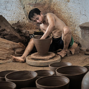 Pottery Artist by Petrus Arif - Professional People Factory Workers