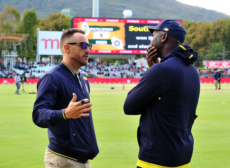 South Africa captain Faf du Plessis (L) chats to head coach Ottis Gibson before the 2018 T20 International match against India at Newlands Cricket Ground, Cape Town on 24 February 2018.