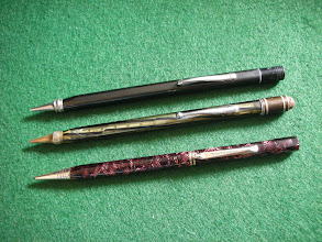 Photo: Eversharp square lead pencils probably mid-late 1930's  Odd pencils. The one in the middle has a transparent barrel, although I don't think it was a demonstrator .   The bottom pencil is in a colour pattern known as black and burgundy pearl web.