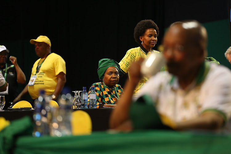 Nkosazana Dlamini-Zuma looks on as ANC party delegates break for tea on Monday. President Jacob Zuma is in the foreground.
