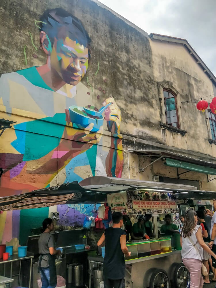 street art in penang cendol eating boy wall mural