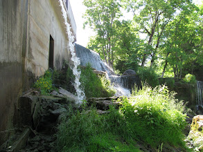 Photo: Very small hydro-electric plant near waterfall