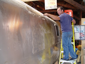 Photo: Removing the clear coat finish from the trailer.