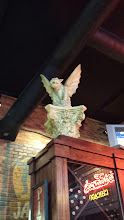 Photo: but why is there a gargoyle in the restaurant?