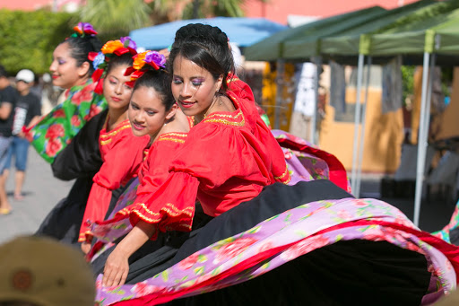 Dancers.jpg - A swirl of colors on stage along the main public walkway in Loreto.