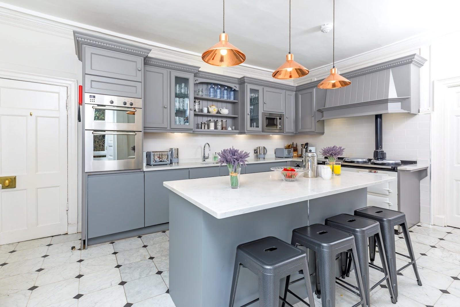 Stylish minimalist kitchen designs, Modern grey kitchen- open plan kitchen with grey cabinets, island, chairs & appliances