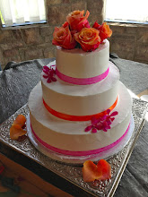 Photo: Spring wedding cake: totally smooth w/hot pink & orange alternating ribbon wrap. (View after fresh flowers.)