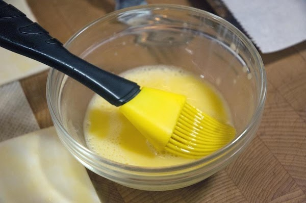 Whisk the egg with a just a touch of water.