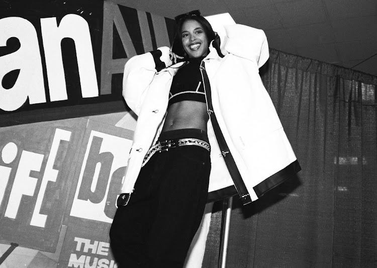 The late American R&B singer Aaliyah (Aaliyah Dana Houghton) poses for a photo backstage at Madison Square Garden on October 5 1995 in New York City. The singer died at the age of 22.