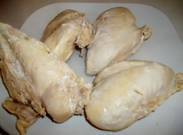 Cook chicken breasts; cool and dice into bite size pieces.