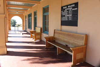 Photo: The train bulletin reflects the time when this was a real train station. Trains don't stop here anymore.