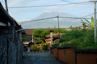 Photo: Behind the town looms Gunung Agung. It last erupted in 1963-64 and is 9,944 ft. high.
