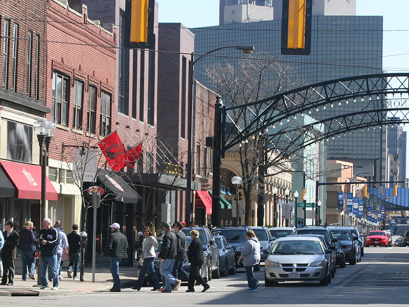 busy Short North street with cars and pedestrians
