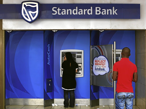 Nice and easy: Customers queue to draw money from an ATM outside a branch of Standard Bank in Cape Town. If the proposed state bank gets off the ground, it may be years before it can compete with the established retail banks that have ATMs across SA. Picture: REUTERS