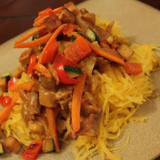 Spaghetti Squash With Veggies & Tofu In A Curry Peanut Sauce.