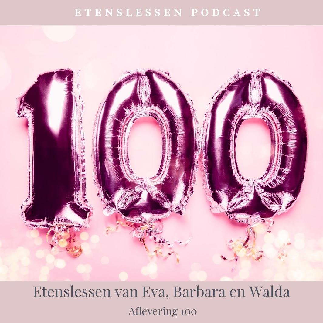Roze aluminium ballonnen gevuld met helium die het getal 100 weergeven