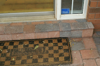 Photo: DETAILS! Covering the concrete step with thin-shaved interlock bricks.