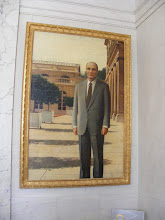 Photo: An upper level antechamber to the President's office has portraits of all deceased Fifth Republic Presidents - here, Francois Mitterand.