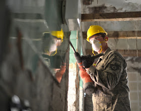 Photo: U.S. Air Force Staff Sgt. Andrew Kaufmann breaks tile off a bathroom wall at an elementary school in Ogulin, Croatia, June 24, 2014. The school bathrooms are being renovated by Airmen from the 133rd and 148th Civil Engineering Squadron, and 219th RED HORSE Squadron in partnership with the Croatian army. Croatia is a Minnesota state partner under the National Guard State Partnership Program. (U.S. Air National Guard photo by Staff Sgt. Austen Adriaens/Released)