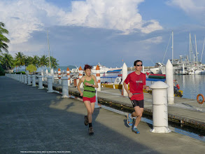 Photo: Tracy Chan and yours truly (KC) going for a morning run surrounding the scenic areas of Sutera Harbour. (Patric Yee holding camera)