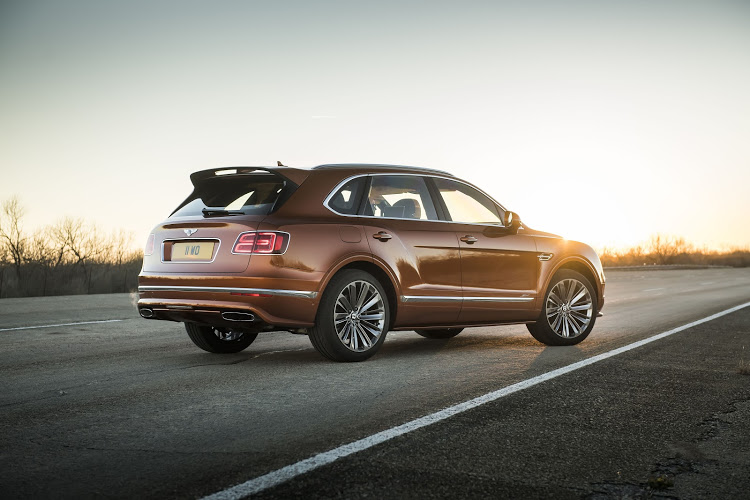 Rear wing and 22-inch wheels identify this as the king of Bentley SUVs.