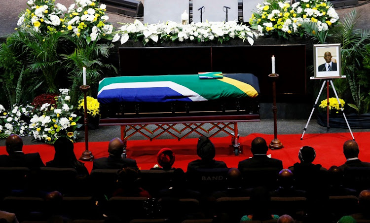 A portrait of the late Dr Zola Skweyiya is displayed alongside casket during his special official funefal service held at the CRC Church in Lynwood, Pretoria, on 21 April 2018. Picture: PHILL MAGAKOE