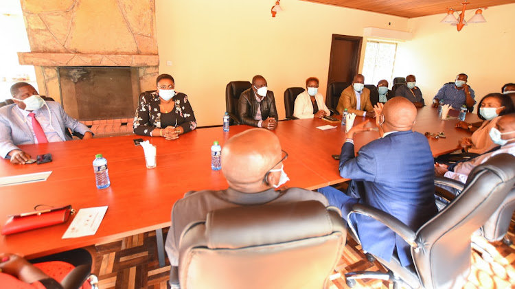 Deputy President William Ruto (in black leather jacket) with allies on Thursday, June 18