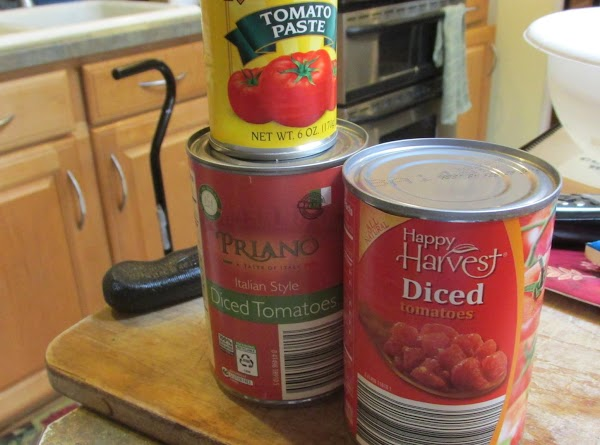 Next add the diced tomatoes & tomato paste & stir to blend mixture together.