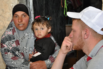Photo: Semi with his little sister and his mother. His mothers tells us about the position of the women, which became stronger in last years by founding a handicraft cooperation.