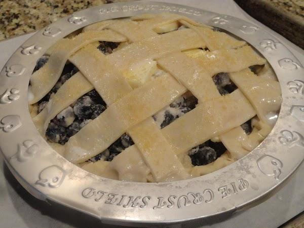 Cut second pie crust into strips to create lattice. Top pie with lattice following...