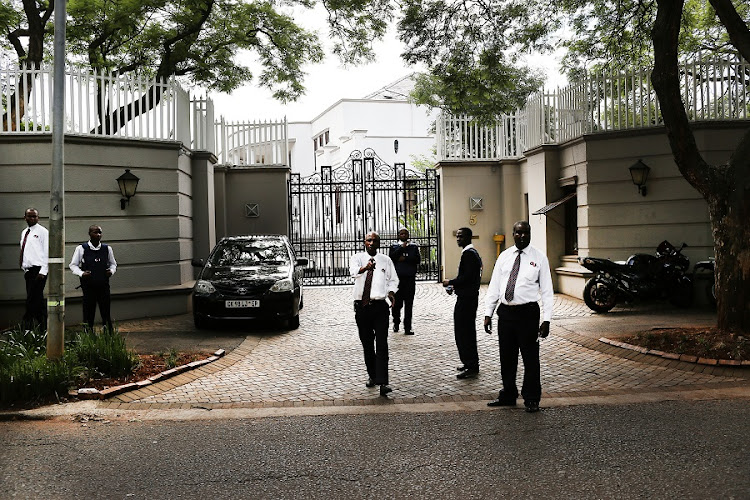 Security gaurds try to prevent photographs being taken, outside property owned by The Guptas, in Saxonwold, Johannesburg. Picture: ALON SKUY/THE TIMES