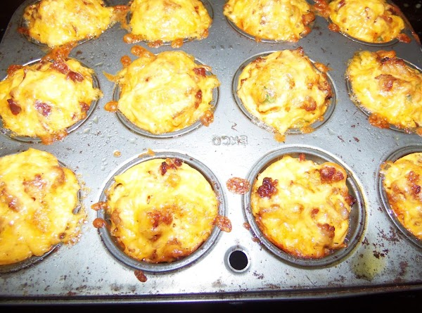 Fill the tins 1/2 way up. top with more cheese and place in the...