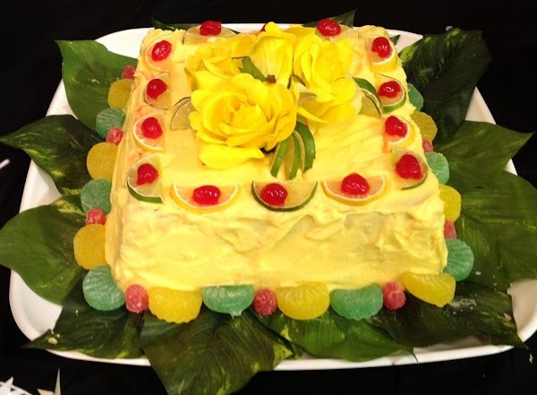 Garnish cake with additional Lemon and lime slices if desired, and accent with maraschino...