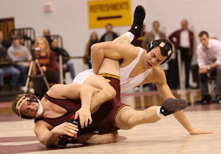 Photo: 174 Logan Storley (Minnesota) dec. Nick Heflin (Ohio State) 4-2