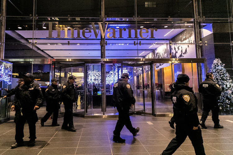 NYPD officers stand near the Time Warner Center Building after the building was evacuated due to a bomb threat, in the Manhattan borough of New York City, New York, U.S., December 6, 2018.